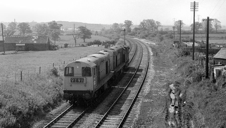 English Electric type 1 Bo-Bo, 8042 and 8192, propel a brake van southwards at Bagworth, Leicestershire