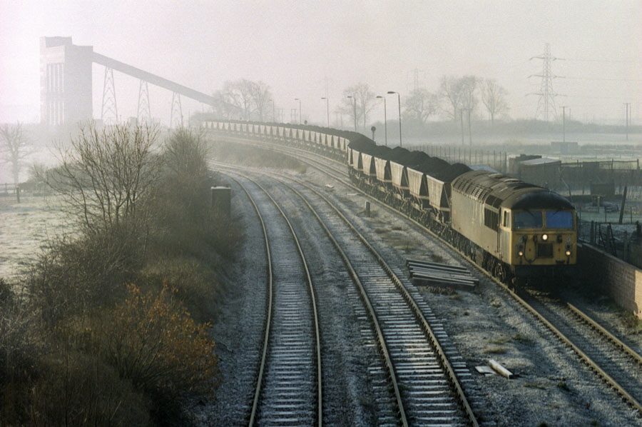 Class 56 Co-Co diesel locomotive no. 56066 departs with a lengthy coal train from the rapid coal loader at Bagworth, Leicestershire