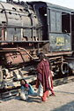 Women coal gatherers and YG 2-8-2 steam locomotive